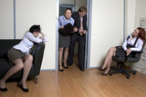 Colleagues struggle in door for chance be first in boss`s office poster