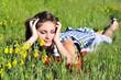 teen girl laying on the meadow