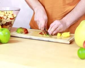 Slicing mango - Preparing fruit salad