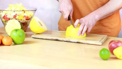 Slicing melon - Preparing fruit salad close-up