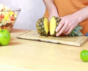 Slicing pineapple - Preparing fruit salad