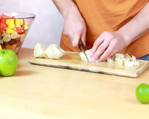 Slicing pomelo - Preparing fruit salad