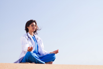 nurse practicising yoga meditiation