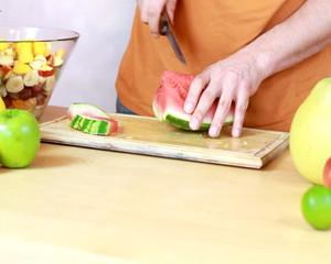 Slicing watermelon - Preparing fruit salad