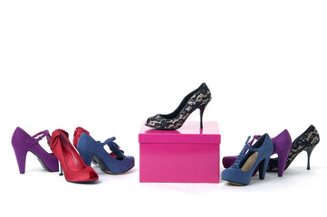 Pile of women's shoes with red  gift box