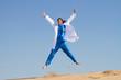 intern jumping on beach