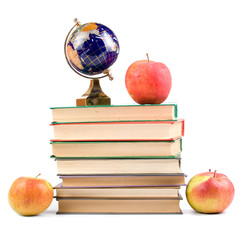Apple, globe and books