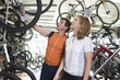 Mature couple choose a new bike