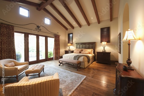 Spacious high beamed bedroom