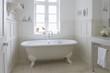 Freestanding roll top in panelled bathroom, London