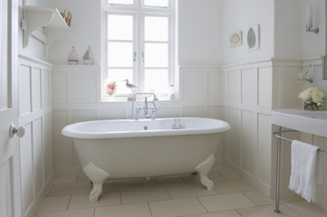 Freestanding roll top in panelled bathroom, London