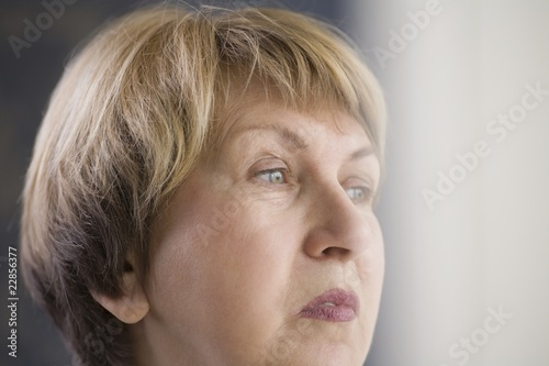 Mature woman with downturned mouth