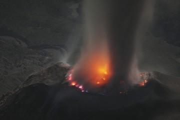 Molten lava glows in volcanic crater of Santiaguito, Santa Maria, Guatemala