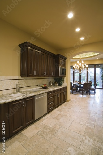 Spacious kitchen with dark wood fitted units