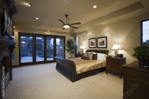 Dark wood furniture in bedroom with ceiling fan from moodboard