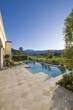 Paved poolside area and summer landscape