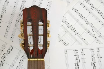 Guitar with music score background