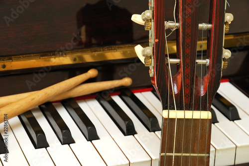 Drum sticks, guitar and piano keyboard - 22863114