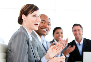 Portrait of smiling businessteam applauding a presentation