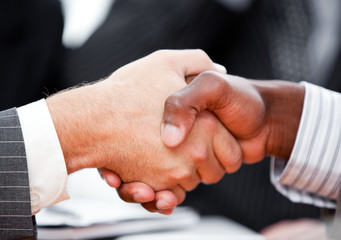 Close-up of a handshake between two businessmen