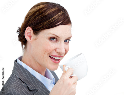 Portrait confident businesswoman drinking a cup of coffee agains