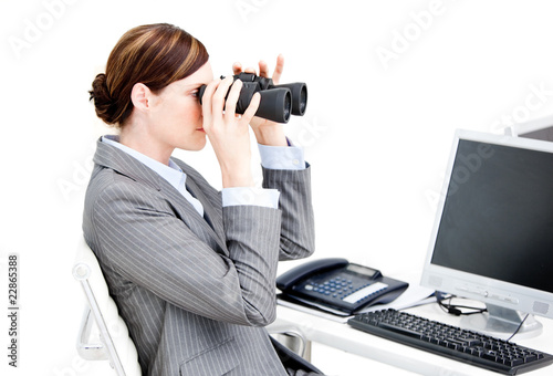 Nice businesswoman using binoculars