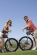 Mature couple on cycling holiday, face to face