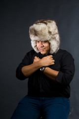 Young man in black shirt and grey fur hat