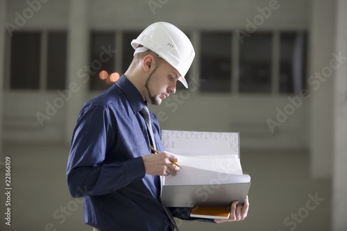 Young man holds documentation file