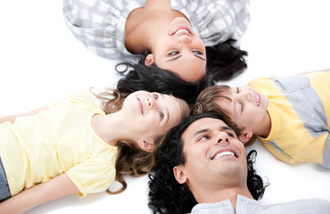 Smiling family lying on the floor together