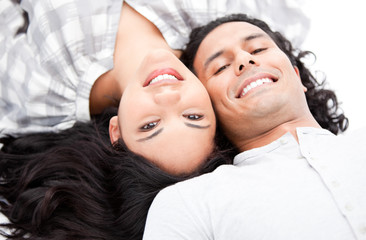 Laughing couple relaxing on the floor