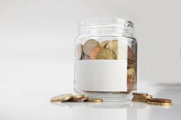 Jar of coins with label