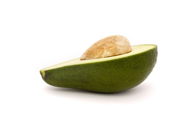 half an avocado with stone isolated on white