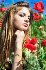 pensive girl in poppy field