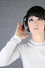 futuristic fashion woman hearing music headphones
