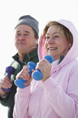 Close up of couple exercising with hand weights