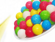 Постер, плакат: Конфеты драже разноцветные на тарелке
