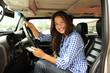 woman driving her new bulletproof truck