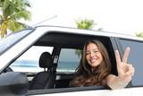 car rental: happy woman in her car near the beach - Fine Art prints