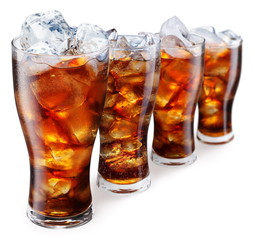 Glasses with cola and ice cubes