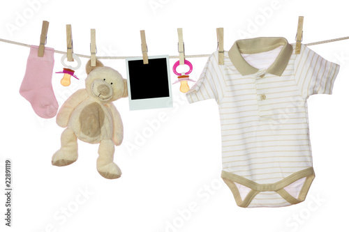 Baby goods and photo hanging on the clothesline