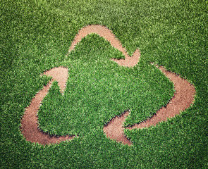 Recycling symbol in a field of grass