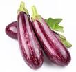 Purple eggplants with leaves