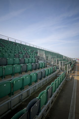 bleacher seating in an empty grandstand