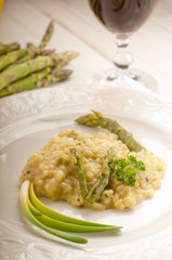 asparagus rice over dish and red wine