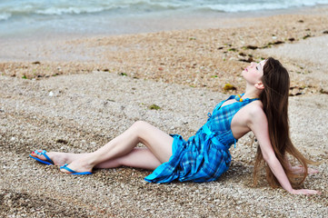 young woman posing near the sea