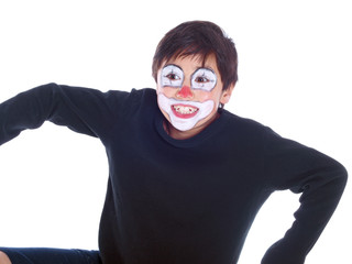 happy boy with clown face playing jumping jack puppet
