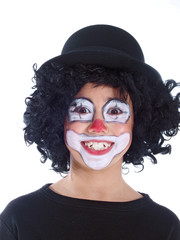 happy boy dressed up as a clown isolated on white background