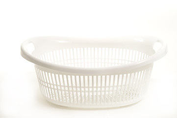 white plastic laundry basket