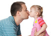 little girl and her dad giving kiss